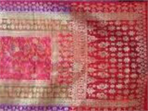 Ikat Kepala Gandi Palembang Aceh kerajinan kain songket palembang aspal putih