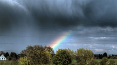 Rainbow through rain clouds wallpaper   AllWallpaper.in