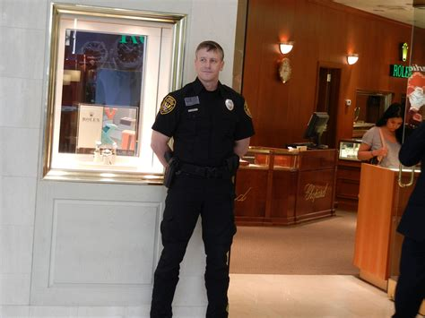 Armed Security Officer by Security Guard Images
