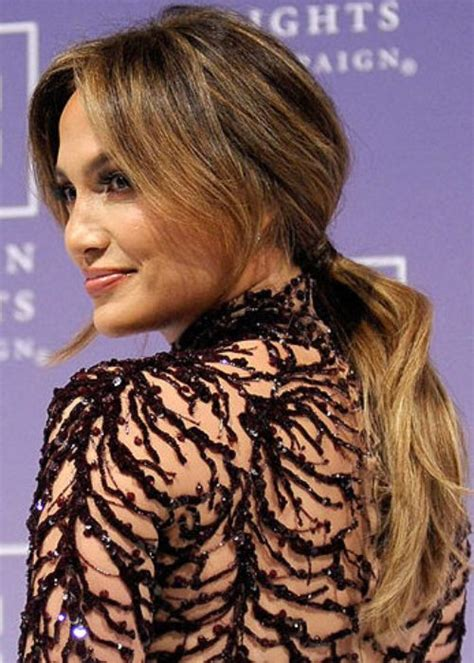 Hairstyles of Jennifer Lopez with bangs   styloss.com