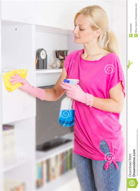 cleaning couches at home woman cleaning home royalty free stock photo image 31852295