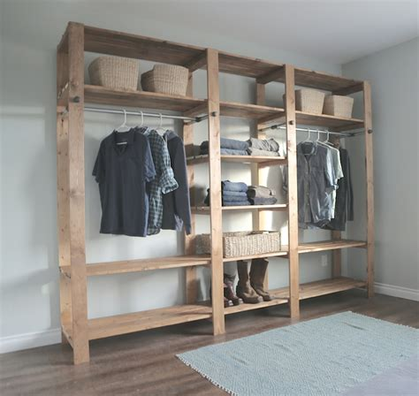 white industrial style wood slat closet system with - How To Make Closet Organizer System