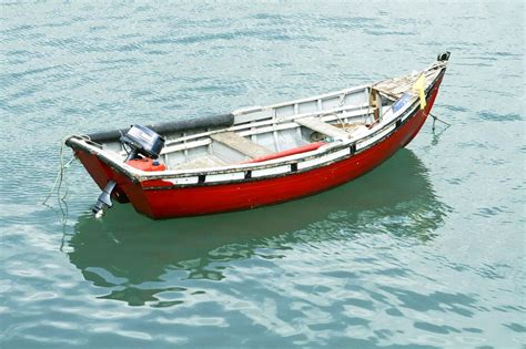 boat picture file alone boat on water surface jpg