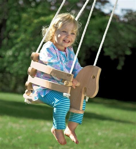 baby on swing wooden horse swing contemporary kids playsets and