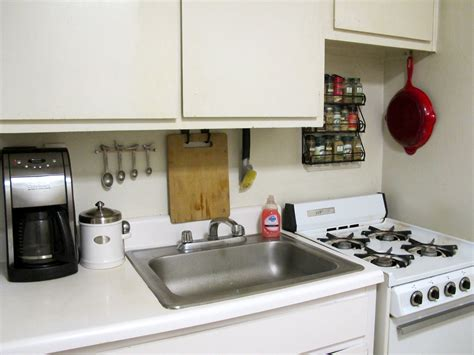 under cabinet appliances kitchen kitchen silver single sink near black coffee maker on
