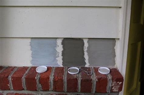 picking a new siding color by painting some test swatches siding colors bricks and flagstone