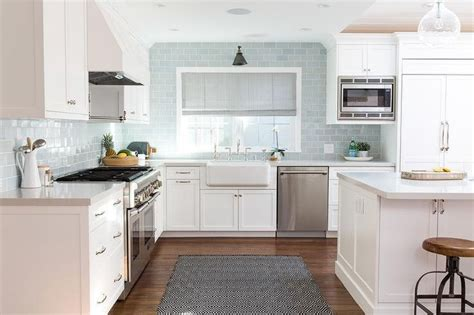 light blue accents give this white kitchen backsplash a 1000 images about kitchen on pinterest