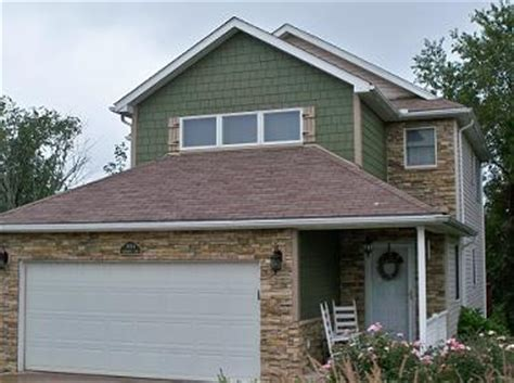green shingle siding with brown roof combination front yard shingle siding