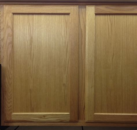 how to paint stained kitchen cabinets staining or painting kitchen cabinets