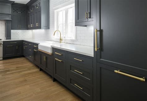 white cabinets with antique brass hardware hot new kitchen trend dark cabinets subway tile