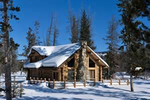 This luxurious log cabin is situated in the idaho mountains covered
