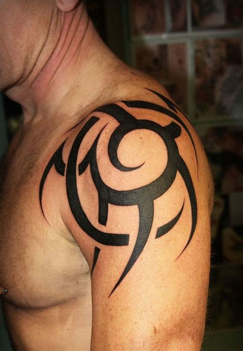 tattoo on the shoulder meaning tribal shoulder tattoos designs ideas and meaning