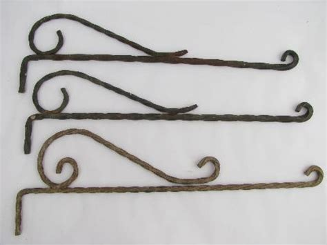 curtain rod hangers lot vintage wrought iron hangers or sign holders antique