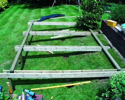 building a deck on a sloped backyard decking built into a sloping bank deck pinterest