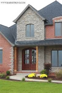 brick and stone house traditional exterior chicago by bj armstrong custom homes