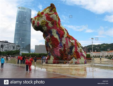 guggenheim dogs puppy by jeff koons guggenheim museum frank gehry stock photo royalty free image