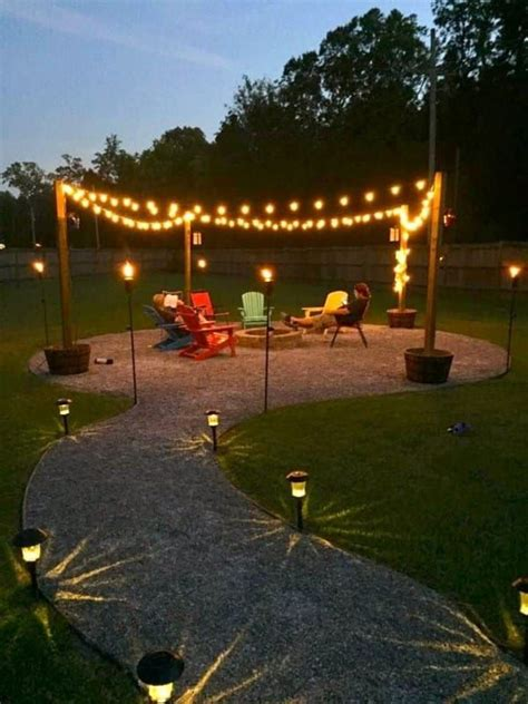 homeowners tear up their pretty grass to create a beautiful backyard pit string lights