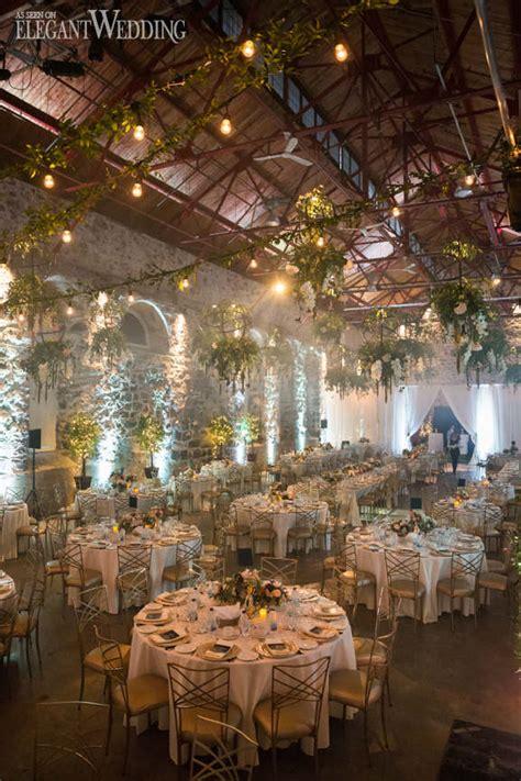 modern indoor garden wedding in montreal elegantwedding ca industrial wedding with hanging greenery elegantwedding ca