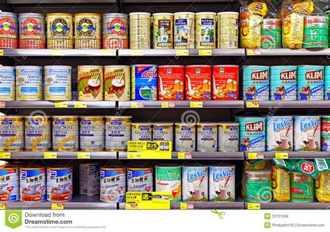 Shelf Of Product by Milk Powder Products At Supermarket Editorial Stock Image