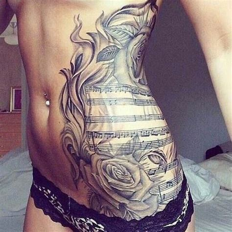 tattoos between breast large sheet with roses between breast and hip