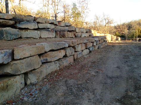 Landscape Rock Owasso Sandstone Boulder Retaining Wall Installation In Tulsa