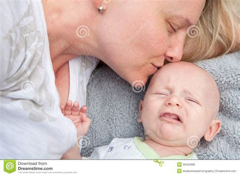 comforting a crying baby mom comforting crying baby royalty free stock photos