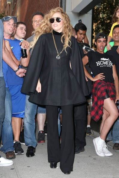 arriving in style lady gaga chose a vintage cadillac to take her to lady gaga s a line cape trend alert classic capes