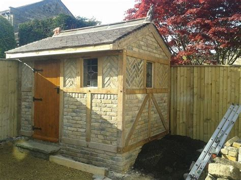 garden shed built  reclaimed bricks  green oak
