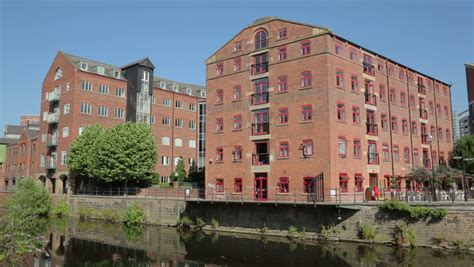 water reflection of riverside apartments along river aire