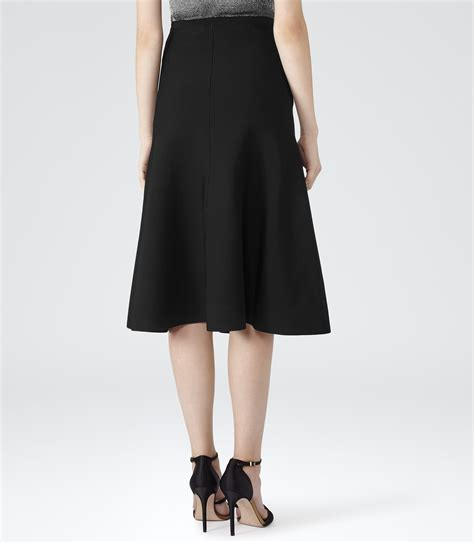 comet black a line midi skirt reiss