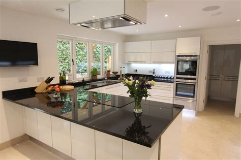 German Designer Kitchens German Handle Less Kitchen Kingston Upon Thames With High Gloss Lacquered Sand Frontal And