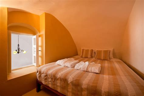cave bedroom accommodation of nefeles luxury suites in fira thehotel gr