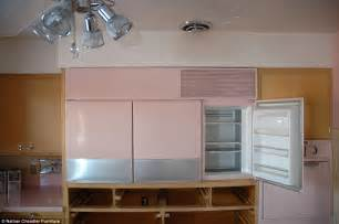 pretty in pink inside the immaculate chicago kitchen frozen in time since it was abandoned in