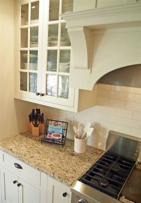 25 best ideas about venetian gold granite on white kitchen cabinets granite