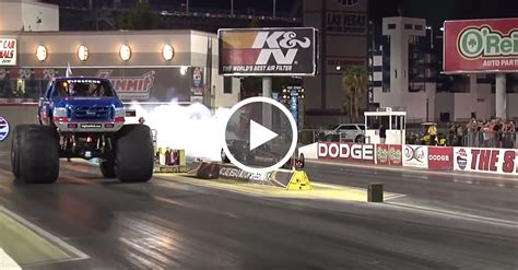 monster truck drag race bigfoot surprises fans at a local drag strip by racing a