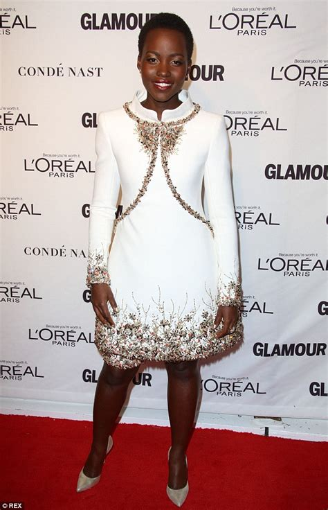 lupita nyong o shines in a white crystal encrusted gown at