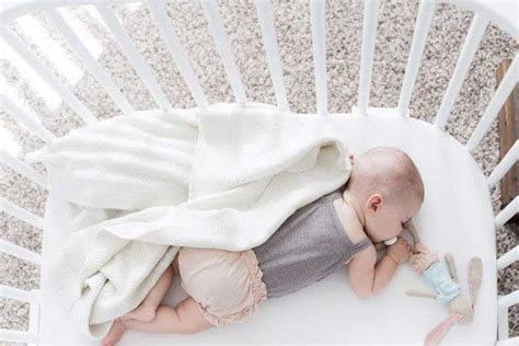 what helps sleep better infant co sleeper that attaches to parents bed babybay