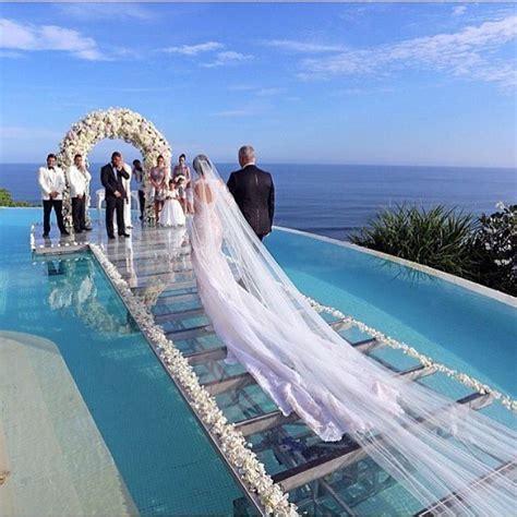 Beautiful ocean seaside wedding Aisle is glass over water
