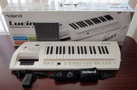 Keyboard Roland Lucina roland lucina ax 09 synthesizer keytar keyboard white