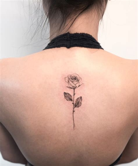 rose on back tattoo inkstylemag