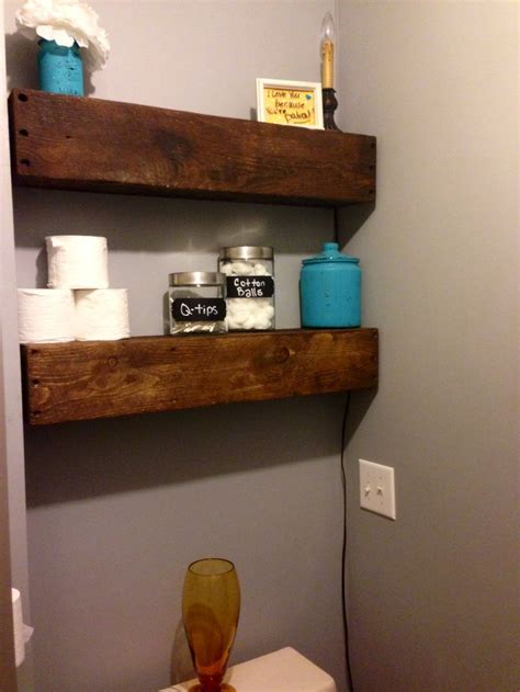 floating shelves made from pallet wood and barn wood