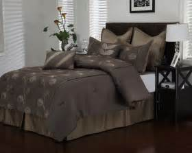 purple and black bedding set with floral pattern on the