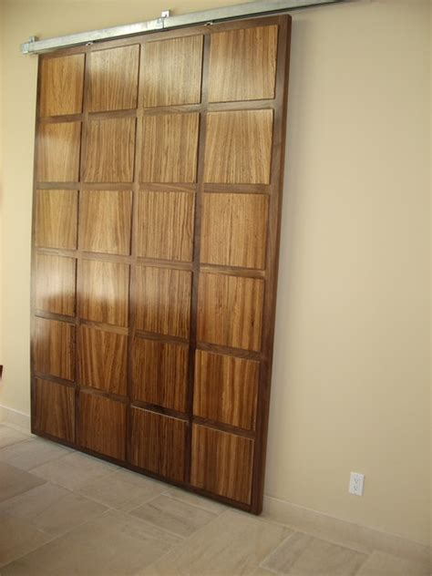 Hanging A Interior Door Walnut And Zebra Wood Hanging Door Eclectic Interior Doors Los Angeles By Upstairs