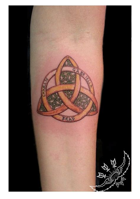 gold tattoo artist johnny b trinityknot family celtic green and