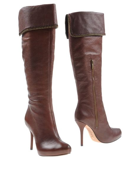 dkny boots in brown lyst