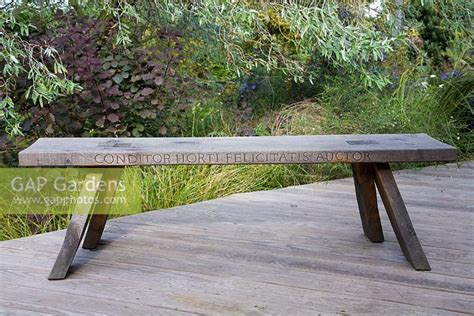 bench in latin gap gardens oak bench with inscription in latin by