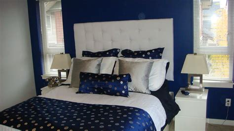 navy blue silver white bedroom with white padded