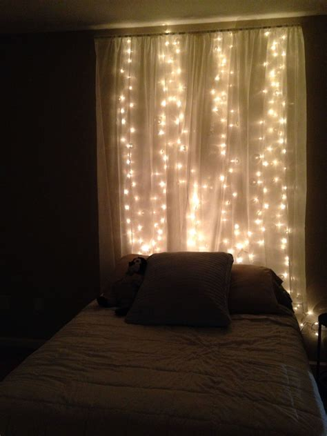 string lights  sheer curtain headboard  bedroom