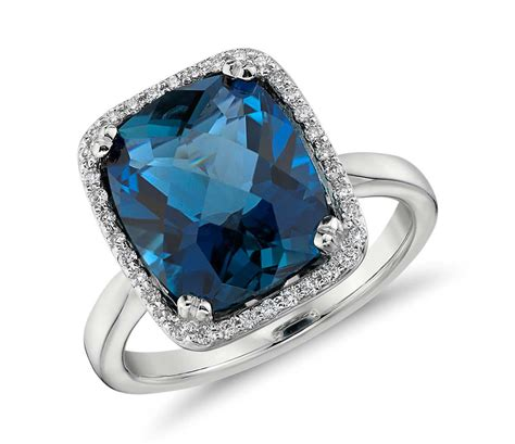 blue topaz and halo cushion cut ring in 14k