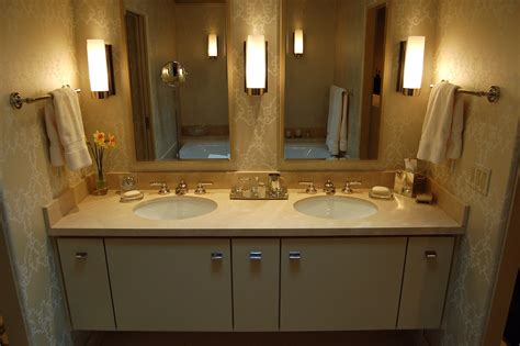 Stylish decoration of bathroom with double sink vanity and faucets